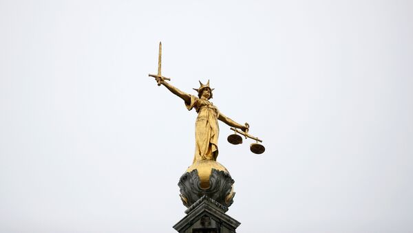 A statue of Lady Justice is seen at Old Bailey central criminal court in London, Britain, November 25, 2019.  - Sputnik International