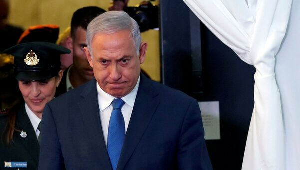 FILE PHOTO: Israeli Prime Minister Benjamin Netanyahu looks on as he arrives to review an honor guard with his Ethiopian counterpart Abiy Ahmed during their meeting in Jerusalem September 1, 2019.  - Sputnik International