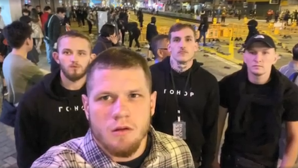 Members of the far-right Ukrainian group Gonor pose during a street protest in Hong Kong - Sputnik International