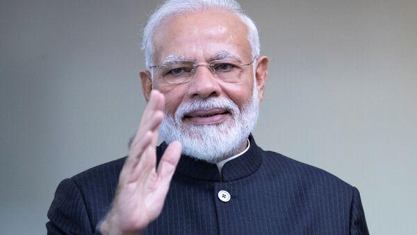 India's Prime Minister Narendra Modi greets the media prior to the BRICS summit in Brasilia, Brazil November 14, 2019 - Sputnik International