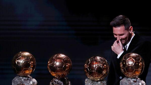 December 2, 2019  Barcelona's Lionel Messi with his Ballon d'Or trophies - Sputnik International