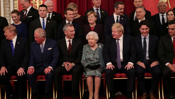 Leaders of NATO alliance countries, and its secretary general Jens Stoltenberg, join Britain's Queen Elizabeth, Prince Charles, Prime Minister Boris Johnson, U.S. President Donald Trump, German Chancellor Angela Merkel, French President Emmanuel Macron and Canadian Prime Minister Justin Trudeau for a group picture as they gather for to mark 70 years of NATO Alliance during a reception at Buckingham Palace, London, Britain December 3, 2019. - Sputnik International