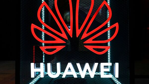 FILE PHOTO: The Huawei logo is pictured at the IFA consumer tech fair in Berlin, Germany, September 5, 2019. - Sputnik International