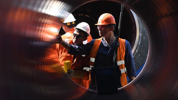 Employees work at the construction site of the Nord Stream 2 pipeline outside the town of Kingisepp, Leningrad region, Russia - Sputnik International