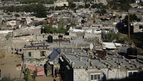 An impoverished area in the southern Gaza Strip refugee camp of Khan Yunis is pictured on May 13, 2019. - Sputnik International