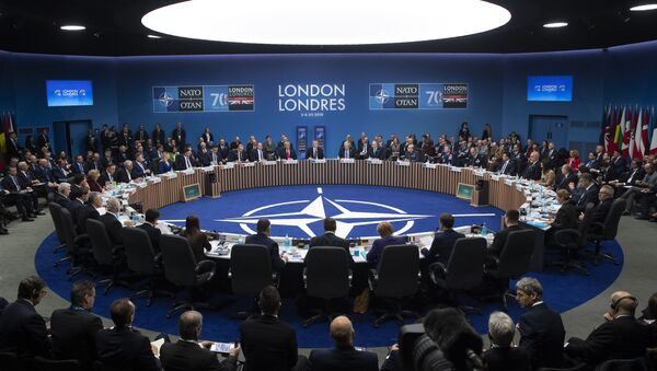 NATO Secretary General Jens Stoltenberg makes an opening statement during a plenary session at the NATO summit at The Grove, Wednesday, Dec. 4, 2019, in Watford, England - Sputnik International