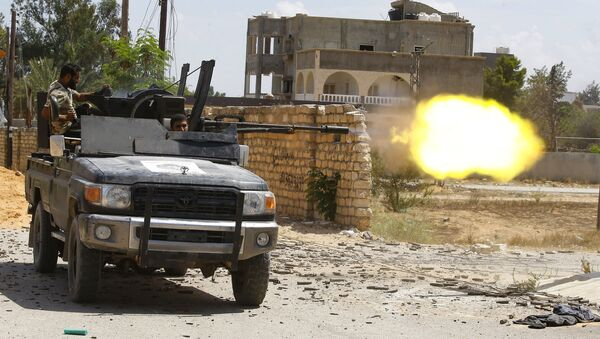 A fighter loyal to the internationally recognised Libyan Government of National Accord (GNA) fires a truck-mounted gun during clashes with forces loyal to strongman Khalifa Haftar in the capital Tripoli's suburb of Ain Zara, on September 7, 2019. - Sputnik International