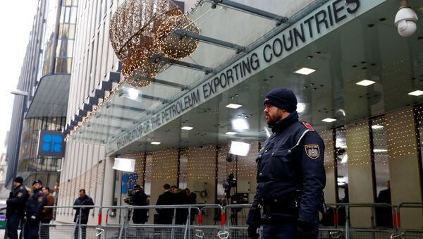 Journalists and police officers stand outside the Organisation of the Petroleum Exporting Countries (OPEC) headquarters in Vienna, Austria December 5, 2019.  - Sputnik International