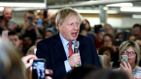 Britain's Prime Minister Boris Johnson delivers a speech to workers during a Conservative Party general election campaign visit to John Smedley Mill in Matlock, central England, on December 5, 2019.  - Sputnik International