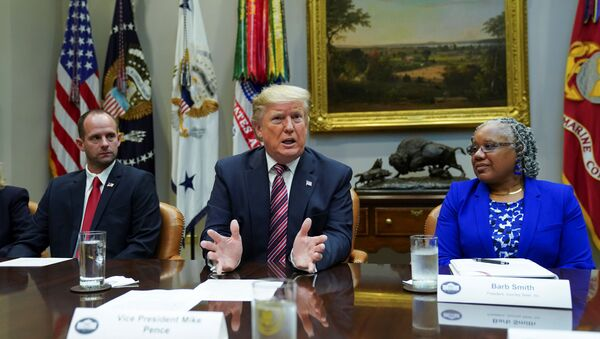 President Donald Trump speaks while sitting between Ryan Newby, Vice President of the Bank of Laverne and Barb Smith, the President of  Journey Steel, while participating in a roundtable on small business and red tape reduction accomplishments in the Roosevelt Room at the White House in Washington, U.S. December 6, 2019.  - Sputnik International