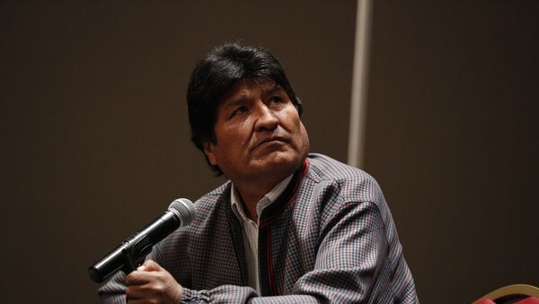 Former Bolivian President Evo Morales, who was granted asylum in Mexico, looks up toward a video playing on a screen during a press conference in Mexico City, Wednesday, Nov. 20, 2019.  - Sputnik International