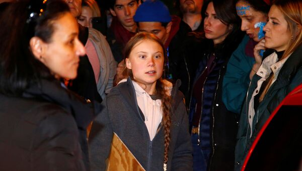Climate change activist Greta Thunberg is seen before departing a climate change protest march due to security concerns, as COP25 climate summit is held in Madrid, Spain, December 6, 2019. - Sputnik International