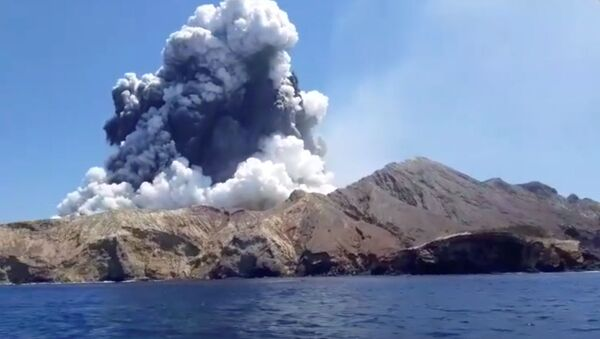 Smoke from the volcanic eruption of Whakaari, also known as White Island, is pictured from a boat, New Zealand December 9, 2019 in this picture grab obtained from a social media video - Sputnik International