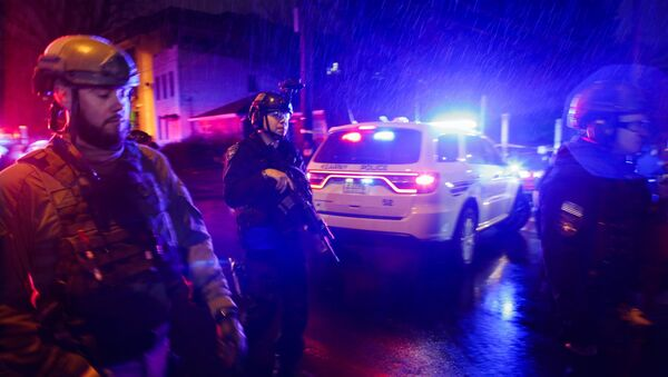 Law enforcement personnel guard near the scene following a shooting, Tuesday, Dec. 10, 2019 - Sputnik International