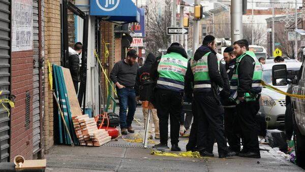 A demolition and recovery crew works at the scene of the December 10, 2019 shooting at a Jewish Deli on December 11, 2019 in Jersey City.  - Sputnik International