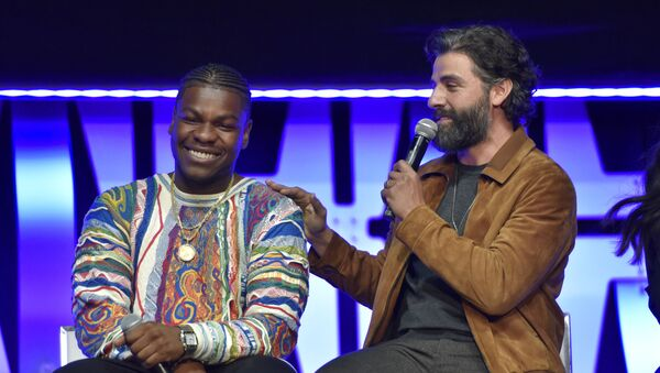 John Boyega, from left, and Oscar Isaac participate during the Star Wars: The Rise Of Skywalker panel on day 1 of the Star Wars Celebration at Wintrust Arena on Friday, April 12, 2019, in Chicago. - Sputnik International