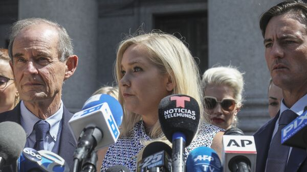 In this Aug. 27, 2019, photo, Virginia Roberts Giuffre, center, who says she was trafficked by sex offender Jeffrey Epstein, holds a news conference outside a Manhattan court where sexual assault claimants invited by a judge addressed a hearing following Epstein's jailhouse death in New York - Sputnik International