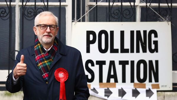 Britain's opposition Labour Party leader Jeremy Corbyn poses outside a polling station after voting in the general election in London, Britain, December 12, 2019 - Sputnik International