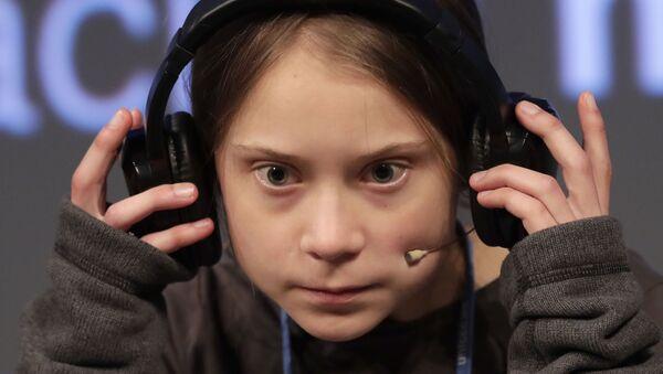 Climate activist Greta Thunberg adjusts the headphones during a press conference in Madrid, Friday Dec. 6, 2019 - Sputnik International
