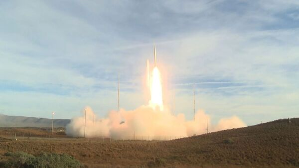 This video grab taken from a DoD (US Department of Defense) handout video released on December 12, 2019, shows a ballistic missile being launched from Vandenberg Air Force Base, California - Sputnik International