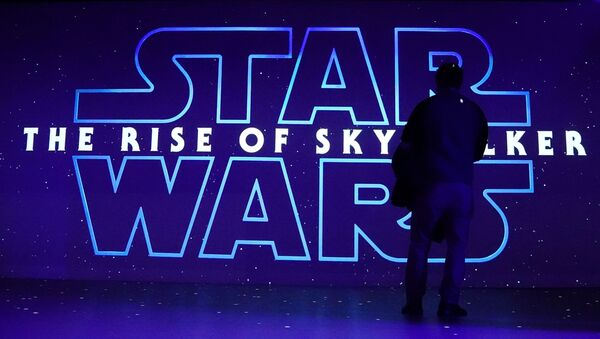 A man watches a trailer for Star Wars: The Rise of Skywalker at the Dolby store in the Manhattan borough of New York City, New York, U.S., December 5, 2019. - Sputnik International