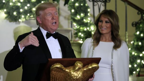 President Donald Trump speaks in the Grand Foyer of the White House during the Congressional Ball, Thursday, Dec. 12, 2019 in Washington, as First Lady Melania Trump watches. - Sputnik International