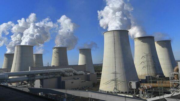 In this Sunday, September 30, 2018 photo water vapour clouds rise from the cooling towers of the Jaenschwalde lignite-fired power plant of Lausitz Energie Bergbau AG (LEAG) in Jaenschwalde, Germany.  - Sputnik International