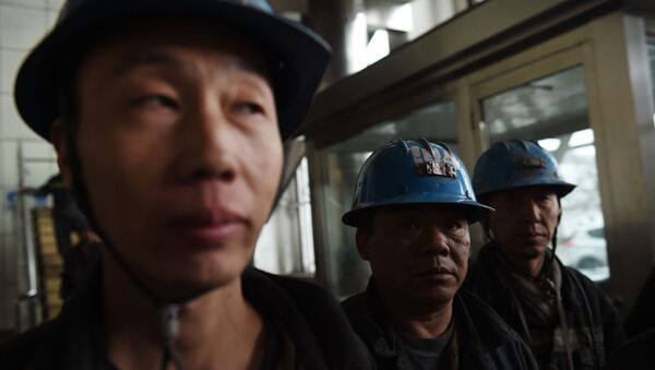 In this photo taken on November 19, 2015, coal miners wait to enter a mine at Datong, in China's northern Shanxi province. - Sputnik International