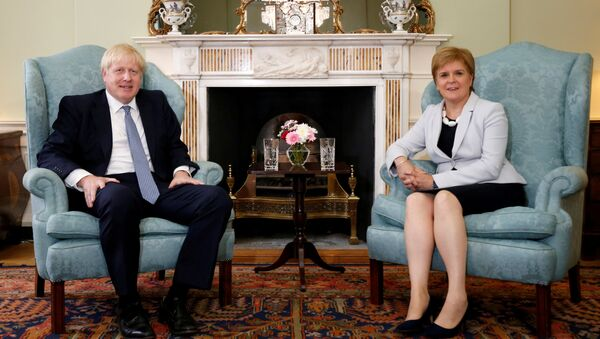 Britain's Prime Minister Boris Johnson poses for a photograph with Scotland's First Minister Nicola Sturgeon at Bute House in Edinburgh, Britain, July 29, 2019 - Sputnik International