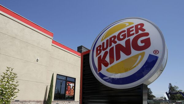 his April 25, 2019, file photo shows a Burger King in Redwood City, Calif. Burger King is introducing a plant-based burger in Europe. But it's not the Impossible Whopper that's been a hit with U.S. customers. Instead, a Dutch company called The Vegetarian Butcher will supply the new soy-based Rebel Whopper. It will go on sale Tuesday, Nov. 12, at 2,400 restaurants across Europe.  - Sputnik International