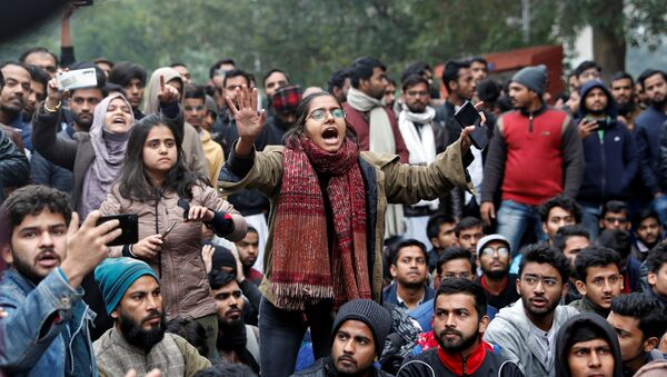 A student of the Jamia Millia Islamia university reacts during a demonstration after police entered the university campus on the previous day, following a protest against a new citizenship law, in New Delhi, India, December 16, 2019 - Sputnik International
