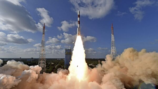 This handout photo provided by the Indian Space Research Organization shows PSLV-C48 lifting off at the Satish Dhawan Space Center in Sriharikota, India, Wednesday, Dec. 11, 2019. India's Polar Satellite Launch Vehicle successfully launched RISAT-2BR1 along with nine commercial satellites, according to a press release. RISAT-2BR1 is a radar imaging earth observation satellite weighing about 628 kg, it said - Sputnik International