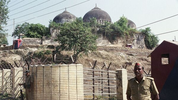 FILE - In this Oct. 29, 1990, file photo, Indian security officer guards the Babri Mosque in Ayodhya, closing off the disputed site claimed by Muslims and Hindus - Sputnik International