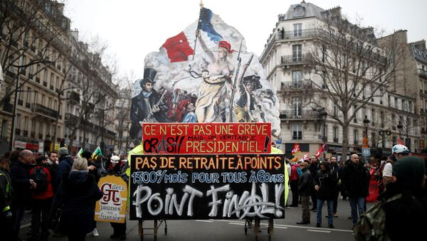 A float with a drawing of the painting La Liberte guidant le peuple (Liberty Leading the People) by Eugene Delacroix is seen during a demonstration against French government's pensions reform plans in Paris as part of a day of national strike and protests in France, December 5, 2019 - Sputnik International
