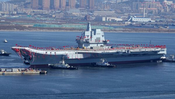 Type 001A, China's second aircraft carrier, is transferred from the dry dock into the water during a launch ceremony at Dalian shipyard in Dalian, northeast China's Liaoning Province, April 26, 2017 - Sputnik International