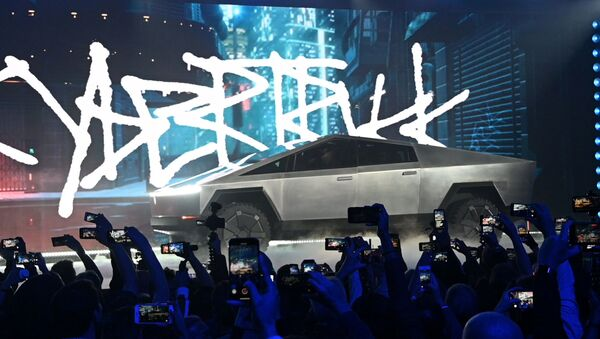Nov 21, 2019;  Hawthorne, CA, U.S.A; The Tesla Cybertruck takes the stage at an unveiling of the long awaited pickup truck from the company at the TeslaDesign Studio in Hawthorne, Calif. - Sputnik International