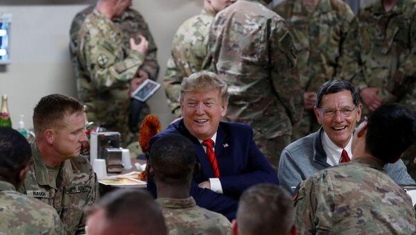 U.S. President Donald Trump eats dinner with U.S. troops at a Thanksgiving dinner event during a surprise visit at Bagram Air Base in Afghanistan, November 28, 2019 - Sputnik International