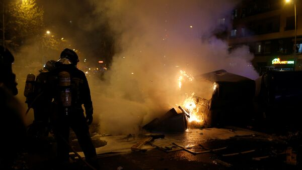 FC Barcelona v Real Madrid - Barcelona, Spain - December 18, 2019  Firefighters respond to a fire as protestors gather in Barcelona during the football match between FC Barcelona and Real Madrid  - Sputnik International