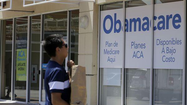 A man walks by a healthcare insurance office in Hialeah, Fla. - Sputnik International