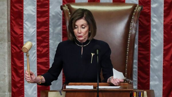 U.S. Speaker of the House Nancy Pelosi (D-CA) bangs the gavel to adjourn the House of Representatives after representatives voted in favor of two counts of impeachment against U.S. President Donald Trump in the House Chamber of the U.S. Capitol in Washington, U.S., December 18, 2019. - Sputnik International