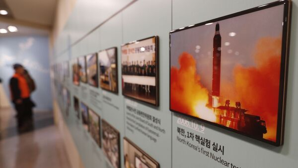 In this Friday, Dec. 13, 2019, photo, an image showing North Korea's missile launch is displayed at the Unification Observation Post in Paju, South Korea, near the border with North Korea - Sputnik International