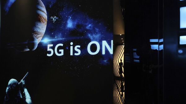 In this Aug. 19, 2019, photo, a guide is silhouetted in an exhibition promoting Huawei's 5G technologies at the Huawei Campus in Shenzhen in Southern China's Guangdong province - Sputnik International