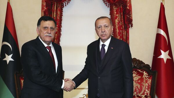 Turkey's President Recep Tayyip Erdogan, right, shakes hands with Fayez al Sarraj, the head of Libya's internationally recognised government, prior to their talks in Istanbul, Sunday, Dec. 15, 2019.  Turkey and Libya had reached an agreement on the delineation of maritime boundaries in the Mediterranean, in November. - Sputnik International