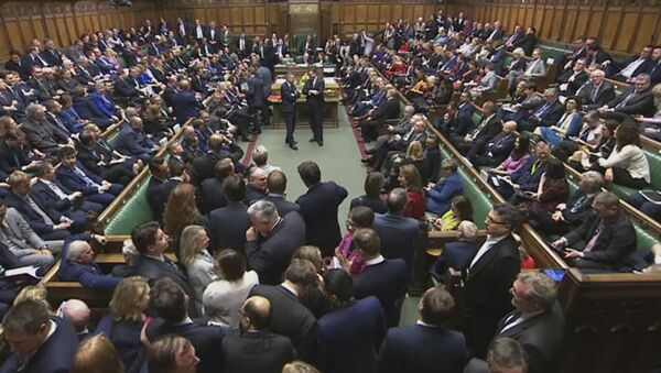 Lawmakers await the result of the vote on The European Union (Withdrawal Agreement) Bill in the House of Commons in London, Friday Dec. 20, 2019. British lawmakers approved in principle Prime Minister Boris Johnson's Brexit bill, clearing the way for the U.K. to leave the European Union next month. The House of Commons voted 358-234 on Friday for the Withdrawal Agreement Bill. - Sputnik International
