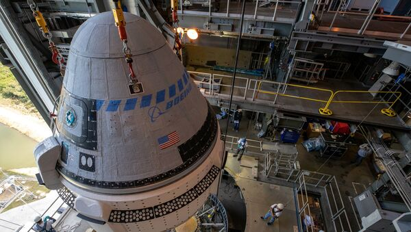 The Boeing CST-100 Starliner spacecraft is guided into position above a United Launch Alliance Atlas V rocket at the Vertical Integration Facility at Space Launch Complex 41 at Cape Canaveral Air Force Station, Florida, U.S. November 21, 2019. - Sputnik International
