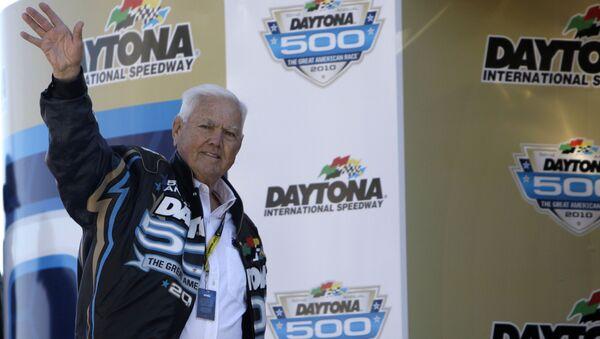 Former driver Junior Johnson waves to fans prior to the Daytona 500 NASCAR auto race at Daytona International Speedway - Sputnik International