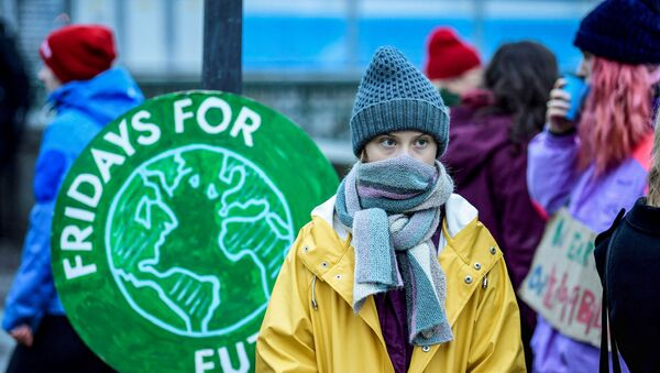 Swedish environmental activist Greta Thunberg attends a climate strike of the Fridays For Future movement outside the Swedish parliament Riksdagen in Stockholm, December 20, 2019.  - Sputnik International