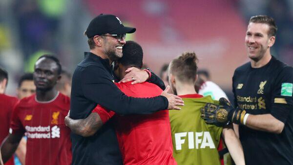 Club World Cup - Final - Liverpool v Flamengo - Khalifa International Stadium, Doha, Qatar - December 21, 2019  Liverpool manager Juergen Klopp and his players celebrate winning the Club World Cup - Sputnik International