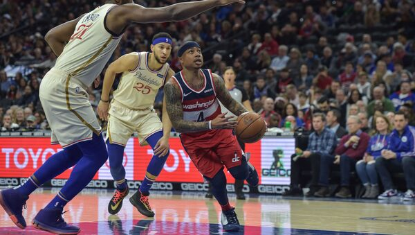 Washington Wizards guard Isaiah Thomas (4) drives to the basket as Philadelphia 76ers center Joel Embiid (21) defends during the first quarter of the game - Sputnik International