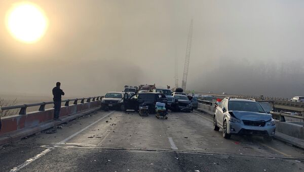 Damaged vehicles are seen after a chain reaction crash on I-64 in York County, Virginia, U.S. December 22, 2019 - Sputnik International